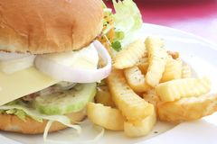 Classy Restaurant Hamburger Meal. During the Day Royalty Free Stock Photography