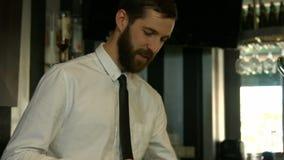 Classy waiter polishing wine glass stock video footage