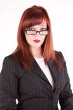 Classy woman. Beautiful eyes staring over the rim of her glasses Stock Photo