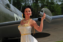 Classy woman with British WWII aircraft Royalty Free Stock Image