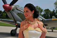 Classy woman with British WWII aircraft Stock Photo