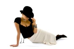 Classy Woman Lounging In Black Hat Royalty Free Stock Photos