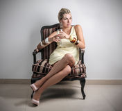 Classy woman. A classy woman sitting in a chair royalty free stock photos