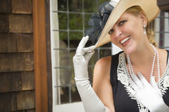 Classy Woman in Twenties Outfit on Porch of Antique House Stock Image