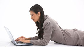 Classy woman using a laptop Royalty Free Stock Photo