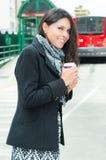Classy woman wearing dark coat and black white Stock Photos