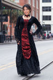 Classy young asian girl standing in black Victorian   dress Royalty Free Stock Photography
