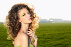 Classy young lady in the fields posing. Lovely day royalty free stock photo