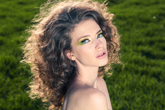 Classy young lady in the fields posing. Lovely day royalty free stock images