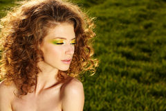Classy young lady in the fields posing. Lovely day royalty free stock photos