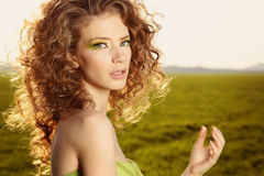Classy young lady in the fields posing. Lovely day royalty free stock photography