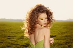 Classy young lady in the fields posing. Lovely day stock image