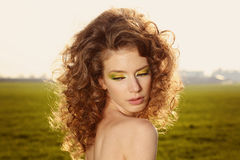 Classy young lady in the fields posing. Lovely day stock photography