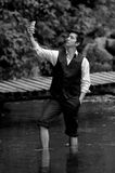 Classy young man taking a selfie in the lake Stock Image