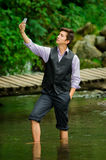 Classy young man taking a selfie in the lake Stock Photos
