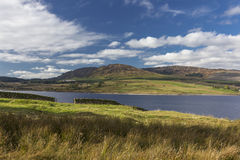 Clatteringshaws Loch from Slopes of Benniguinea Stock Photography