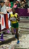 Claudette Mukasakindi running the Olympic Marathon. Rwandan athlete Claudette Mukasakindi enters  St Paul's Churchyard for the 2nd time during the Olympic Women' Stock Photo