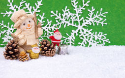 Claus λογαριάζει το χιονάνθρ&om Στοκ Φωτογραφία