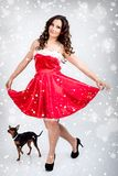 Claus ντύνει τη φθορά santa κοριτσιώ&nu Στοκ Εικόνες