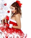 claus одевает модных детенышей женщины santa стоковое изображение