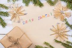 claus bokstav santa till Julkort önskelistautrymme Arkivbild