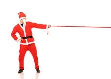 claus chwyt czerwony tasiemkowy Santa Obraz Royalty Free