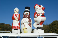 The Claus family. Santa Mrs Claus and frosty the snowman Stock Photography