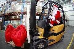 claus forklift operatora Santa magazyn Obrazy Royalty Free