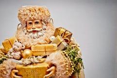 claus gåvor guld- santa Royaltyfria Bilder