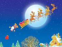 Claus g en baisse son à l'extérieur étrier de Santa Photos libres de droits