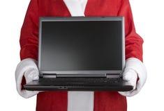 claus holdingbärbar dator santa Royaltyfri Fotografi