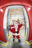 claus powitania pozy czerwieni worek Santa Obrazy Royalty Free