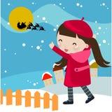 девушка claus смотря santa Стоковые Фото