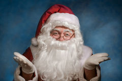 Claus Santa gesturing. Over blue background royalty free stock photo