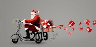 claus santa sparkcykel arkivfoto