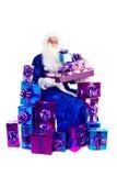 claus udziałów teraźniejszość Santa obsiadanie Zdjęcie Royalty Free