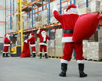 clausas圣诞老人小组工作 免版税库存照片