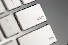Clave de vuelta en el teclado Fotos de archivo