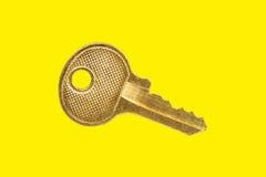 Clave del oro Imagen de archivo libre de regalías