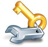 Clave del oro y llave inglesa gris Fotos de archivo libres de regalías