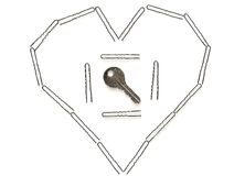 Clave en el corazón. Foto de archivo