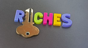 Clave a la riquezas Imágenes de archivo libres de regalías