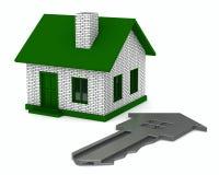 Clave y casa en el fondo blanco Fotos de archivo libres de regalías