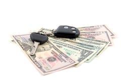 Clave y dólares del coche Fotos de archivo