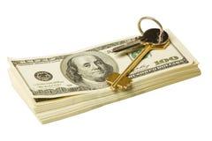 Clave y dinero Fotos de archivo libres de regalías