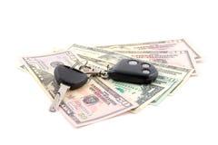 Clave y dólares del coche Foto de archivo