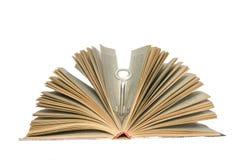 Clave y libros Imágenes de archivo libres de regalías
