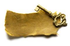Clave y papel imágenes de archivo libres de regalías