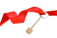Claves de la casa con la cinta roja Imagenes de archivo