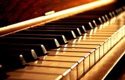 Claves de oro del piano Foto de archivo libre de regalías